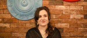 Scarlett Kefford against a brick background